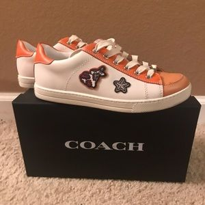 All authentic leather Coach sneakers.